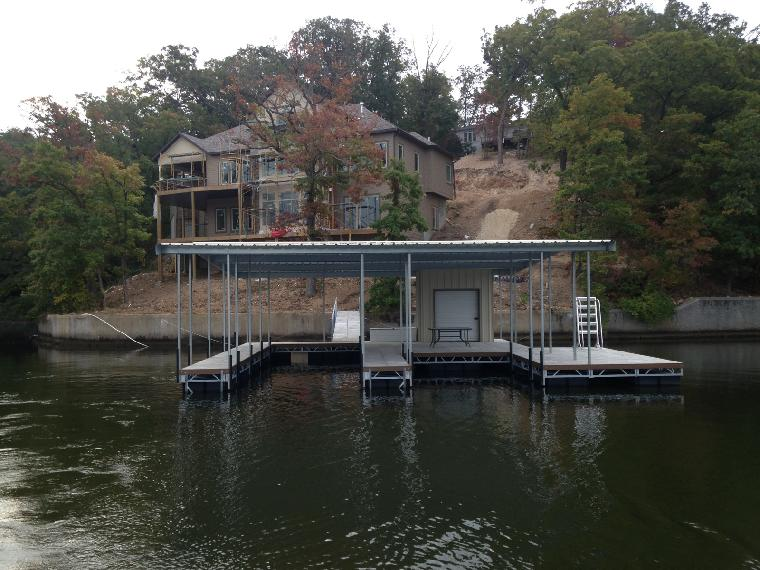 Large residential dock with two wells, large swim dock and large locker. Located at the 31 mile marker.
